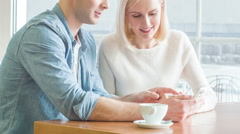 Young couple is discussing something over the smartphone Stock Footage