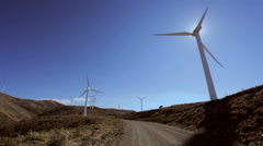 Windmills in wind power farm Stock Footage