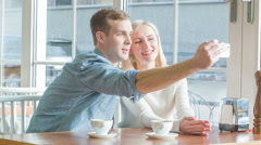 Young couple is taking selfies at the restaurant Stock Footage