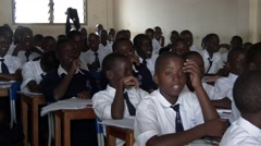 African students studying & talking crowded classroom at school-Education Africa - stock footage