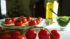 Adding balsamic vinegar to cheese and tomato salad (Caprese). Part of the set Stock Footage