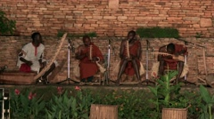 African tribe musicians preparing to play folk music - drums - native african Arkistovideo