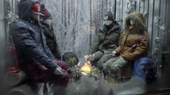 camping mannequin store window display fake paper fire roasting marshmallows 4K - stock footage