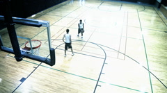 Two Guys Playing Basketball On Indoor Court Stock Footage