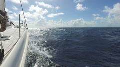 Sailboat cruising over caribbean sea - stock footage
