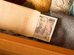Keeping money in the drawer  to avoid tax, called Tansu Yokin in Japanese - stock photo