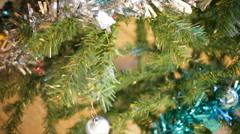 Snowman and Christmas Balls on Christmas Tree, panning camera shot in HD Stock Footage