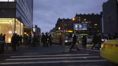 Cab and bus driving Houston Street night people walking across intersection NYC Stock Footage
