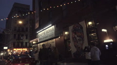 Driving through Little Italy night, bright lights, people walking, tourists NYC Stock Footage