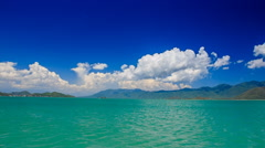 gleams of azure sea against distant islands sky cumulus clouds - stock footage