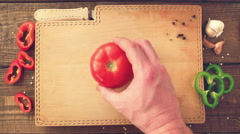 Tomato being chopped into eighths by male hands. Stock Footage