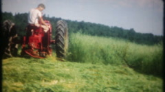 3148 cutting the grass with tractor blade - vintage film home movie Stock Footage