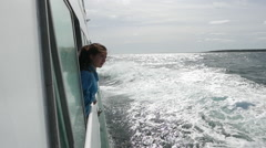 Young Girl looking out from the side of a Ferry Stock Footage