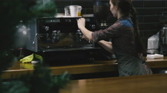 Young girl working in a coffee shop Stock Footage