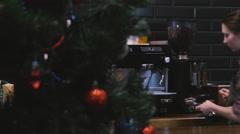 Barista prepares coffee. Near Christmas tree Stock Footage