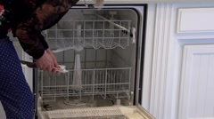 Loading and Unloading a Dishwasher in Timelapse Stock Footage