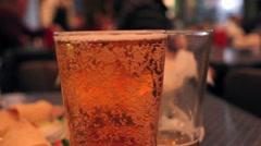 Glass of Beer in Restaurant Stock Footage