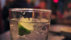 Gin Drink with Lime and Ice - stock footage