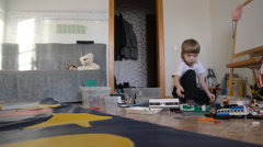A child plays in the constructor and toys Stock Footage