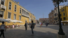Walking between the buildings of Campo Santo Stefano, Venice Stock Footage