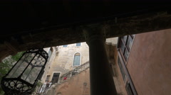 Man walking on an outside staircase located in an interior courtyard, Venice Stock Footage