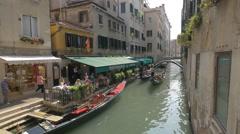Rio de l'Alboro with restaurant and boats in Venice Stock Footage