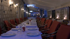Settled tables at Ragusa restaurant in the fortress of Dubrovnik, Croatia Stock Footage