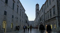People walking on a street near Saint Saviour Church in Dubrovnik, Croatia Stock Footage