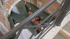 Stock Video Footage of High angle view of a beautiful gondola moving in the canal, Venice