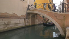 Gondola passing under a bridge in Venice Stock Footage