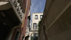 Narrow street with beautiful buildings and massive doors in Venice Stock Footage