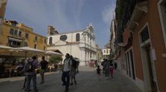 Men and women walking near Santa Maria del Giglio church, Venice Stock Footage