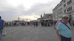 Many tourists walking on Riva degli Schiavoni in Venice Stock Footage