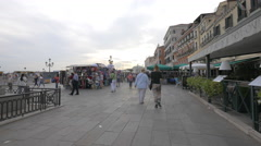 Multi-ethnic tourists walking on Riva degli Schiavoni on a cloudy day, Venice Stock Footage
