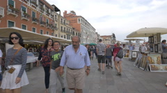 Multi-ethnic tourists walking by restaurants in Venice Stock Footage