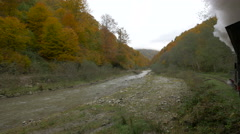 Beautiful view of the valley and autumn forest seen from Mocanita Stock Footage