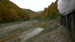Amazing view of Mocanita riding near the valley and autumn forest and hills Stock Footage