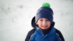 Boy in winter clothes smiling Stock Footage