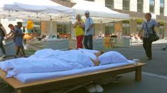 BIEL/BIENNE - SWITZERLAND, AUGUST 2015: sleeping performance, public nudity Stock Footage