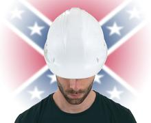 Engineer with flag on background - Confederate flag - stock photo