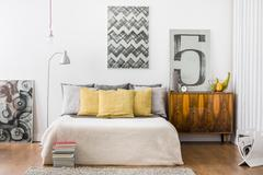 Bright snug bedroom interior - stock photo