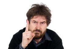 Bearded man threatens with a finger - stock photo