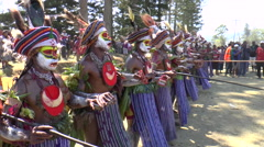 Native aboriginals in customes in tribe show Stock Footage