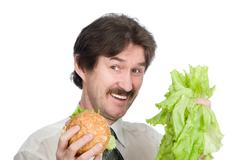 Stock Photo of The man has chosen salad