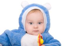 Cute little boy with a warm blue coat on white background Stock Photos