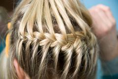 Hairdress a plait - stock photo