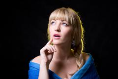 The beautiful girl with a plait against - stock photo