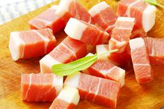 Diced Italian speck on cutting board - stock photo