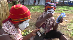 Papuan women paint their face - stock footage