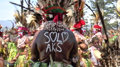 Tribe sign on the back of Aboriginal woman Stock Footage